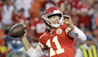 Kansas City Chiefs quarterback Alex Smith (11) throws during the first half of the team's NFL preseason football game against the San Francisco 49ers in Kansas City, Mo., Friday, Aug. 11, 2017. (AP Photo/Charlie Riedel) **FILE**