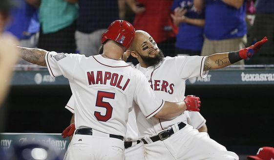 Texas Rangers' Mike Napoli (5) is congratulated by Rougned Odor after hitting a solo home run during the fourth inning of a baseball game against the Houston Astros on Saturday, Aug. 12, 2017, in Arlington, Texas. (AP Photo/Brandon Wade)