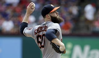 Houston Astros starting pitcher Dallas Keuchel throws to the Texas Rangers in the first inning of a baseball game, Sunday, Aug. 13, 2017, in Arlington, Texas. (AP Photo/Tony Gutierrez)