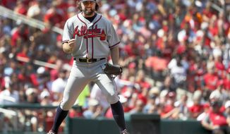 Atlanta Braves starting pitcher R.A. Dickey pumps his fist after getting St. Louis Cardinals' Matt Carpenter to ground out ending the seventh inning of a baseball game Sunday, Aug. 13, 2017, in St. Louis. (AP Photo/Jeff Roberson)