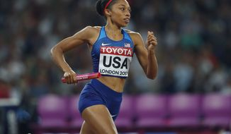 United States' Allyson Felix competes in the women's 4x400-meter final during the World Athletics Championships in London Sunday, Aug. 13, 2017. (AP Photo/Kirsty Wigglesworth)