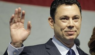 FILE - In this May 20, 2017 file photo, U.S. Rep. Jason Chaffetz waves after addressing the Utah GOP Convention in Sandy, Utah. The Republican race to fill the congressional seat abandoned by Utah's Jason Chaffetz is pitting the state's GOP establishment against further-right conservatives split over two candidates. The winner of Tuesday's primary will be the overwhelming favorite in the November special election in a district where Republican voters outnumber Democrats five-to-one. (AP Photo/Rick Bowmer, File)