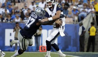 Dallas Cowboys defensive end Taco Charlton sacks Los Angeles Rams quarterback Sean Mannion during the first half of a preseason NFL football game Saturday, Aug. 12, 2017, in Los Angeles. (AP Photo/Jae C. Hong)