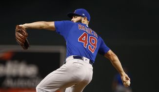 Chicago Cubs' Jake Arrieta throws a pitch against the Arizona Diamondbacks during the first inning of a baseball game Sunday, Aug 13, 2017, in Phoenix. (AP Photo/Ross D. Franklin)
