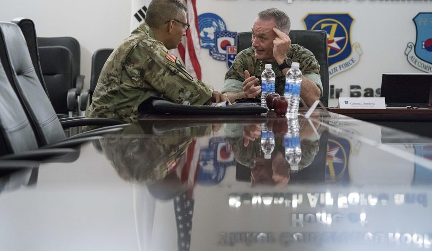 Joint Chiefs Chairman Gen. Joseph Dunford, right, speaks with United States Forces Korea Commander Gen. Vincent Brooks, left, at Osan Air Base, Sunday, Aug. 13, 2017, in Pyeongtaek, South Korea. (AP Photo/Andrew Harnik)