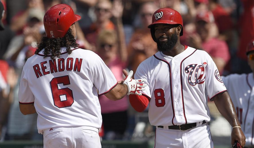 Washington Nationals' Anthony Rendon (6) celebrates his two-run home run with Brian Goodwin (8) during the eighth inning of the first baseball game of a split doubleheader against the San Francisco Giants, Sunday, Aug. 13, 2017, in Washington. (AP Photo/Nick Wass)