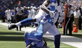 Detroit Lions wide receiver Kenny Golladay (19) catches a 23-yard pass for a touchdown as he is defended by Indianapolis Colts safety Malik Hooker (29) during the first half of an NFL preseason football game, Sunday, Aug. 13, 2017, in Indianapolis. (AP Photo/Darron Cummings)