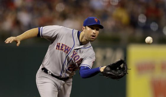 New York Mets third baseman Neil Walker catches a line out by Philadelphia Phillies' Cesar Hernandez during the sixth inning of a baseball game, Thursday, Aug. 10, 2017, in Philadelphia. New York won 10-0. (AP Photo/Matt Slocum)