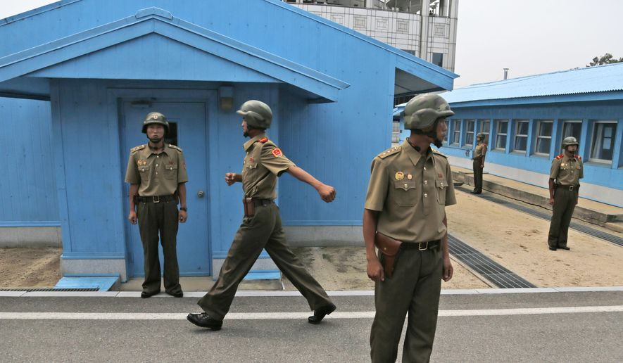 In this Aug. 15, 2015, file photo, North Korean soldiers stand guard at the Demilitarized Zone (DMZ) in North Korea, on Liberation Day, the anniversary of the end of World War II in 1945 and the Korean Peninsula's liberation from Japanese colonial rule. (AP Photo/Dita Alangkara, File)