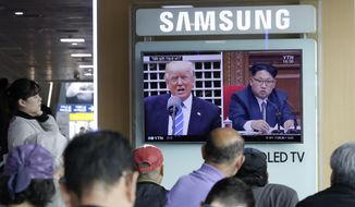 FILE - In the May 2, 2017 file photo, a TV screen shows images of U.S. President Donald Trump, left, and North Korean leader Kim Jong Un during a news program at the Seoul Railway Station in Seoul, South Korea. Tensions between the United States and North Korea tend to flare up suddenly and then fade away almost as quickly, but the latest escalation won't likely go away quite so easily. (AP Photo/Ahn Young-joon, File)
