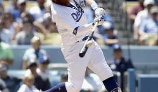 Los Angeles Dodgers' Justin Turner connects for a three-run home run against the San Diego Padres during the fourth inning of a baseball game in Los Angeles, Sunday, Aug. 13, 2017. (AP Photo/Alex Gallardo)