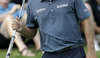 Kevin Kisner reacts after missing a birdie putt on the 15th hole during the third round of the PGA Championship golf tournament at the Quail Hollow Club Saturday, Aug. 12, 2017, in Charlotte, N.C. (AP Photo/John Bazemore)