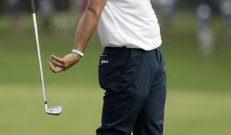 Hideki Matsuyama of Japan, reacts to his shot from the fairway on the 14th hole during the final round of the PGA Championship golf tournament at the Quail Hollow Club Sunday, Aug. 13, 2017, in Charlotte, N.C. (AP Photo/John Bazemore)