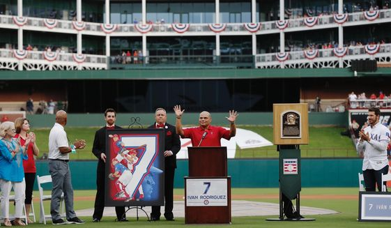 Former Texas Rangers player Ivan Rodriguez speaks during a ceremony to retire his number before a baseball game against the Houston Astros, Saturday, Aug. 12, 2017, in Arlington, Texas. (AP Photo/Brandon Wade)