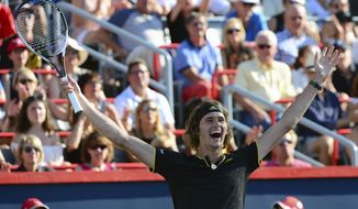 Alexander Zverev, of Germany, celebrates his win over Roger Federer, of Switzerland, in the final of the Rogers Cup tennis tournament, Sunday, Aug. 13, 2017, in Montreal. (Paul Chiasson/The Canadian Press via AP)