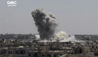 This frame grab from video provided on Sunday, Aug. 13, 2017, by the Ghouta Media Center, a Syrian activist media group, shows smoke and debris rising after a Syrian government ground-to-ground rocket strikes the opposition-held town of Ain Terma, in the Eastern Ghouta suburb of Damascus, Syria on Saturday. (Ghouta Media Center, via AP)