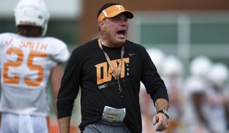 Tennessee head coach Butch Jones yells to players during fall NCAA college football practice in Knoxville, Tenn., Friday, Aug. 11, 2017. (Caitie McMekin/Knoxville News Sentinel via AP)