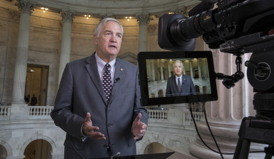 In this July 11, 2017, file photo, Sen. Luther Strange, R-Ala. responds to questions during a TV news interview on Capitol Hill in Washington. (AP Photo/J. Scott Applewhite, File)