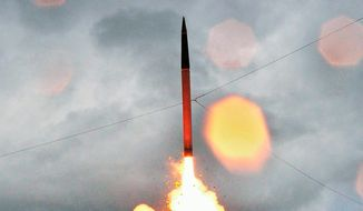 A THAAD missile being launched       Associated Press photo