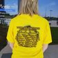 Amanda Connick of North Platte, Nebraska, sports a T-shirt advertising the best times and locations for eclipse-viewing on the Nebraska Sandhills. Photo by Valerie Richardson / The Washington Times