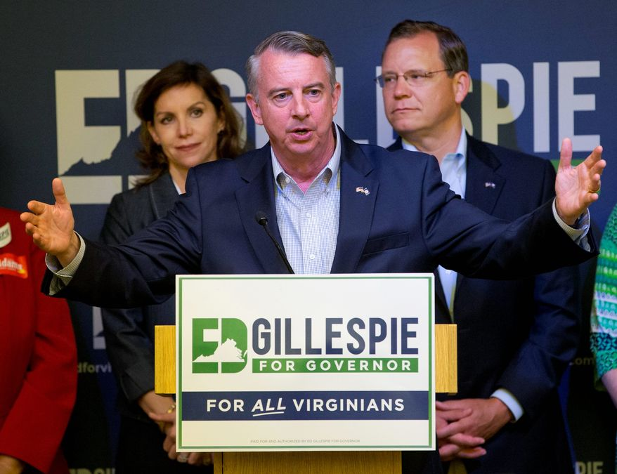 Republican candidate for governor, Ed Gillespie, center, gestures during a news conference with his running mates, Lt. Gov. candidate Jill Vogel, left, and Attorney General candidate John Adams, right, Wednesday, June 14, 2017, in Richmond, Va. (AP Photo/Steve Helber)