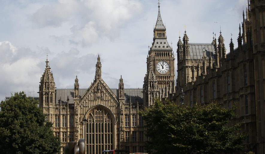 A general view of Palace of Westminster and the Queen Elizabeth Tower which contains the bell known as 'Big Ben' is shown in the file photo from Monday, Aug. 14, 2017. (AP Photo/Alastair Grant) **FILE**