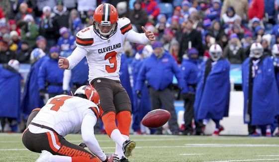 FIKE - In this Dec. 18, 2016, file photo, Cleveland Browns kicker Cody Parkey (3), with Britton Colquitt (4) holding, boots a field goal against the Buffalo Bills during the first half of an NFL football game in Orchard Park, N.Y. After missing three field goals in his debut for Cleveland last season, Parkey rebounded and converted on 20 of 22 attempts. (AP Photo/Bill Wippert, File)