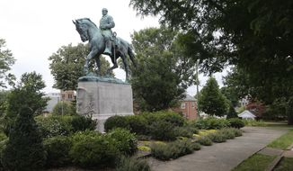The statue of Confederate General Robert E. Lee still stands in Lee park in Charlottesville, Va., Monday, Aug. 14, 2017. The removal of the statue is in litigation and is at the center of the racial tensions and demonstrations in the town. (AP Photo/Steve Helber)