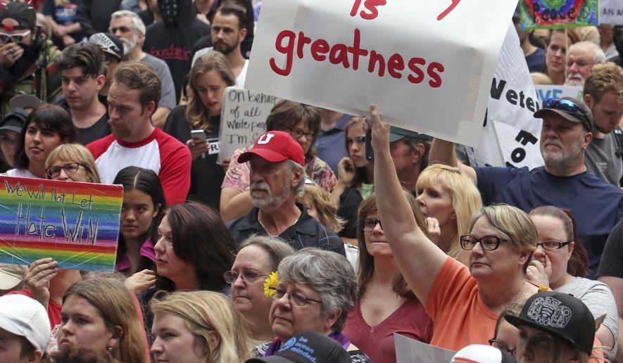People gather for a rally Monday, Aug. 14, 2017, in Salt Lake City. Utah residents held a unity and anti-racism rally Monday night to denounce the messages of hate and violence of white supremacists at a weekend rally in Charlottesville, Va. (AP Photo/Rick Bowmer)