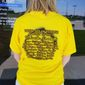 Amanda Connick of North Platte, Nebraska, sports a T-shirt advertising the best times and locations for eclipse-viewing on the Nebraska Sandhills. (Valerie Richardson/The Washington Times)