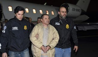 """FILE - In this Jan. 19, 2017, file photo provided U.S. law enforcement, authorities escort Joaquin """"El Chapo"""" Guzman, center, from a plane to a waiting caravan of SUVs at Long Island MacArthur Airport, in Ronkonkoma, N.Y. Guzman wants new lawyers in his U.S. drug trafficking case. Guzman is scheduled to appear in federal court in Brooklyn on Monday, Aug. 14. He's seeking to have his public defenders replaced by private lawyers, but questions remain about how they will get paid. (U.S. law enforcement via AP, File)"""