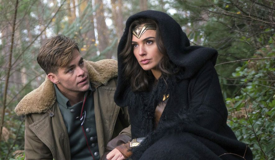 "This image released by Warner Bros. Pictures shows Chris Pine, left, and Gal Gadot in a scene from, ""Wonder Woman."" The film, directed by Patty Jenkins, opens June 2. (Clay Enos/Warner Bros. Pictures via AP)"