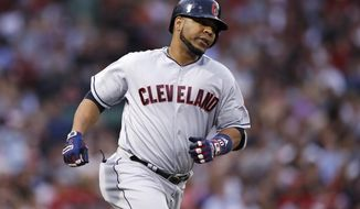 Cleveland Indians designated hitter Edwin Encarnacion rounds the bases on his two-run home run off Boston Red Sox starting pitcher Doug Fister during the fifth inning of a baseball game in Boston, Monday, Aug. 14, 2017. (AP Photo/Charles Krupa)
