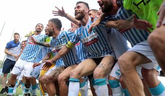 FILE - In this Saturday, May 13, 2017 file photo, Spal players celebrate at the end of their Serie B soccer match against Ternana, at the Libero Liberati stadium in Terni, Italy. A look at Spal, Hellas Verona and Benevento as the promoted teams prepare for this weekend's opening of the Italian league season. (Pianetafoto/ANSA via AP)