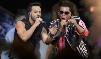 """FILE - This April 27, 2017, file photo shows singers Luis Fonsi, left, and Daddy Yankee during the Latin Billboard Awards in Coral Gables, Fla. An MTV spokesperson said in a statement to The Associated Press on Monday, Aug. 14, 2017, that the 'Despacito' video was not submitted for consideration for nomination at the 2017 Video Music Awards. The hit song's video has not aired on MTV or MTV2, but is being played on MTV Tres, the company's Latin channel. Universal Music Latin Entertainment, the label that released Luis Fonsi and Daddy Yankee's """"Despacito,"""" said they welcome MTV to play Spanish videos on its main channel in a statement to the AP. (AP Photo/Lynne Sladky, File)"""