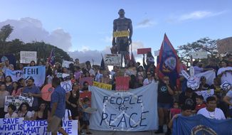 About a hundred people gather at Chief Kepuha Park in Hagatna, Guam for a rally for peace Monday, Aug. 14, 2017.  The U.S. territory has been the subject of threats from North Korea in its escalating war of words with the U.S. President Donald Trump's administration.  (AP Photo/Tassanee Vejpongsa)
