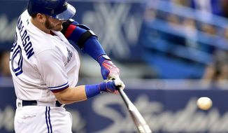 Toronto Blue Jays third baseman Josh Donaldson (20) hits a two-run home run during first-inning baseball game action against the Tampa Bay Rays in Toronto on Monday, Aug. 14, 2017. (Frank Gunn/The Canadian Press via AP)