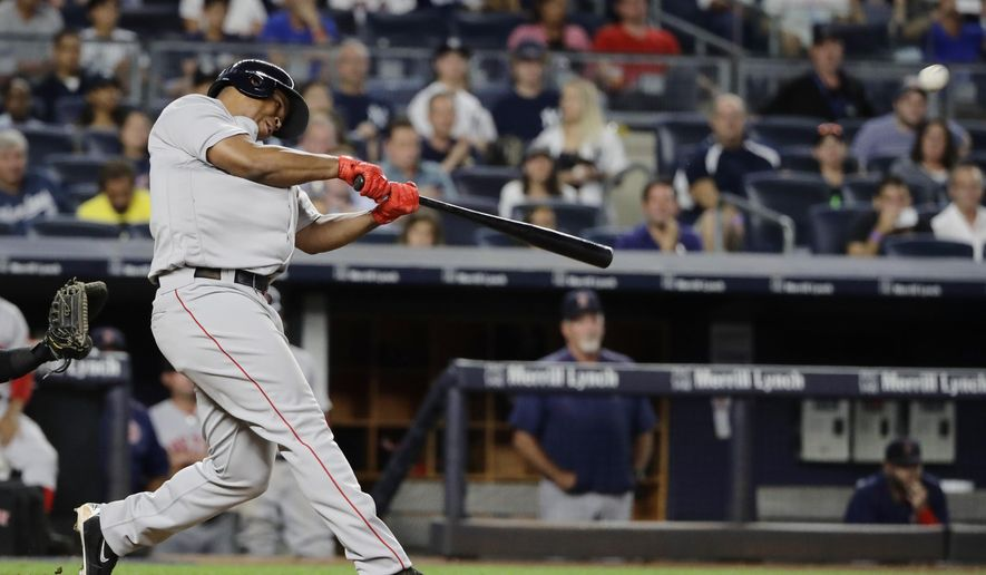 Boston Red Sox's Rafael Devers hits a home run during the ninth inning of the team's baseball game against the New York Yankees on Sunday, Aug. 13, 2017, in New York. (AP Photo/Frank Franklin II)