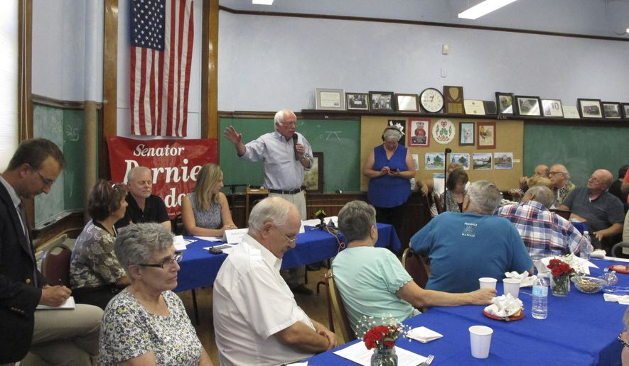 U.S. Sen. Bernie Sanders talks with seniors at the Franklin County Senior Center in St. Albans on Monday, Aug. 14, 2017. Sanders says he will introduce a medicare for all bill shortly after Congress reconvenes in September. (AP Photo/Lisa Rathke)