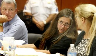 FILE- In this Aug. 3, 2017, file photo, Scott Phillips, left, looks on as his wife Theresa Mullen, center, talk to their attorney Susan Brandt McCrea during the trial in Newark, N.J. The parents of Sydney Phillips and her younger sister, Kaitlyn are seeking a court order to allow the girls to return to their Catholic school in Kenilworth after a dispute over one of them wanting to play on the boys basketball team. A judge on Monday, Aug. 14, refused to overturn a decision to banish the two sisters from their Roman Catholic school after a dispute over one of them wanting to play on the boys basketball team. (Aristide Economopoulos/NJ Advance Media via AP, Pool)