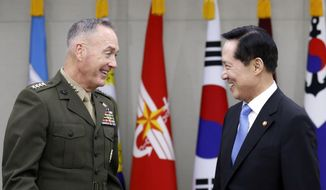U.S. Joint Chiefs Chairman Gen. Joseph Dunford, left, talks with South Korean Defense Minister Song Young-moo during their meeting at the Defense Ministry in Seoul, South Korea, Monday, Aug. 14, 2017. (Kim Hong-Ji/Pool Photo via AP)