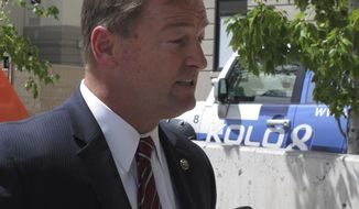 Sen. Dean Heller, R-Nev., talks to reporters outside a veterans health care facility in Reno, Nev., Monday, Aug. 14, 2017. Heller, who is in a tough battle for re-election next year and already faces a GOP primary challenge from the right, said he's glad President Donald Trump sharpened his criticism Monday of the white supremacists who incited violence that turned deadly over the weekend in Charlottesville, Va. (AP Photo/Scott Sonner)