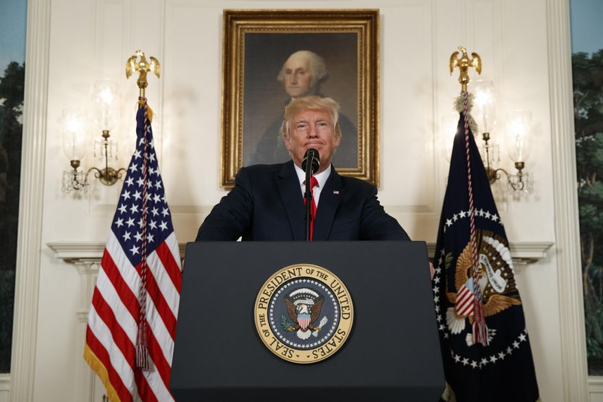 President Donald Trump pauses as he speaks about the deadly white nationalist rally in Charlottesville, Va., Monday, Aug. 14, 2017, in the Diplomatic Room of the White House in Washington. (AP Photo/Evan Vucci)