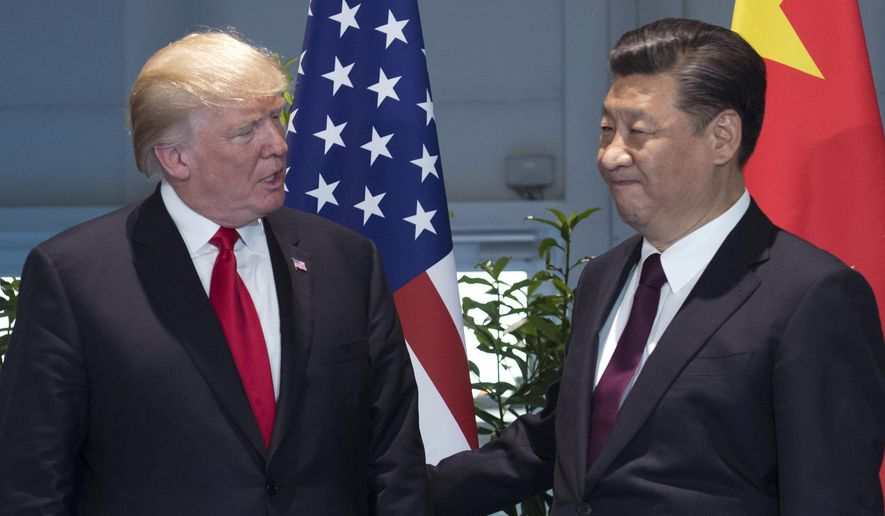 In this July 8, 2017, file photo, U.S. President Donald Trump, left, and China's President Xi Jinping arrive for a meeting on the sidelines of the G-20 Summit in Hamburg, Germany. Trump is planning to sign an executive action asking the U.S. Trade Representative to consider investigating China for the theft of U.S. technology and intellectual property. He is taking the step even as he seeks China's help with the ongoing crisis with North Korea. (Saul Loeb/Pool Photo via AP, File)
