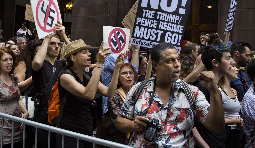 Protestors shout slogans in front of Trump Tower ahead President Donald Trump's visit to the building New York, Monday, Aug. 14, 2017. (AP Photo/Andres Kudacki)