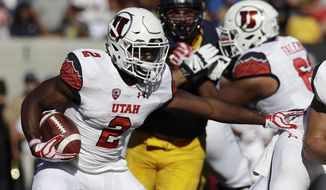 FILE - In this Oct. 1, 2016, file photo, Utah running back Zack Moss (2) carries against California during the first half of an NCAA college football game in Berkeley, Calif. Moss is officially the No. 1 running back for the Utah Utes after a tight camp competition with Armand Shyne ended in a long-term injury to Shyne. (AP Photo/Marcio Jose Sanchez, File)