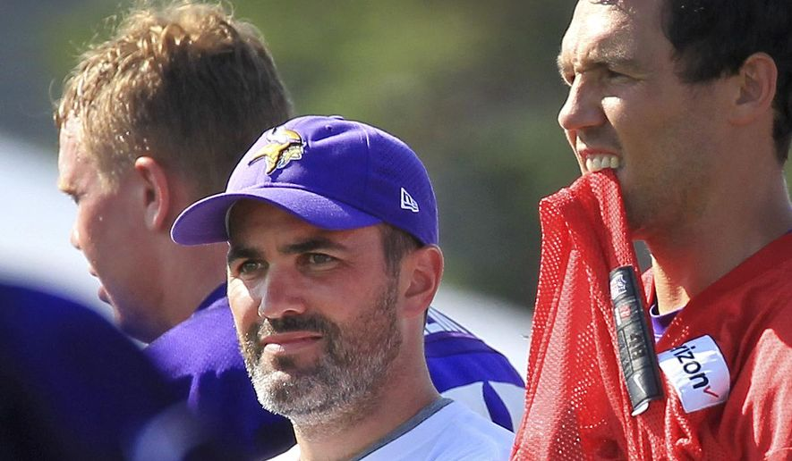 Minnesota Vikings quarterback coach Kevin Stefanski watches practice with quarterback Sam Bradford during NFL football training camp Thursday, July 27, 2017, in Mankato, Minn. Stefanski is the longest-tenured member of the Vikings coaching staff, dating back 12 years when he joined the organization as an office assistant to former coach Brad Childress. Now he is in charge of the quarterbacks, his fourth different job for his third different coach in the organization. (AP Photo/Andy Clayton-King)