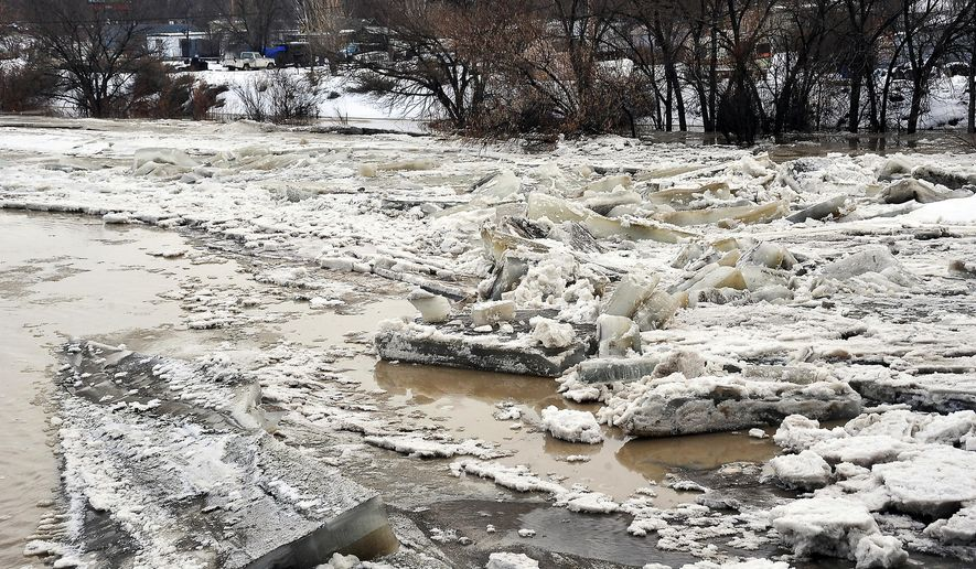 FILE - In this Saturday, Feb. 11, 2017 photo, ice jams up along the Big Horn River just below the Culbertson Bridge in Worland, Wyo. Flooding in Wyoming this year is being blamed for several river deaths and causing millions of dollars in damage. The full extent of the damage is still being tallied and some damage is so extensive that the repair work will stretch beyond this year. (Karla Pomeroy/Northern Wyoming Daily News via AP, File)/Northern Wyoming Daily News via AP)