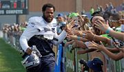 Seattle Seahawks defensive end Michael Bennett said he's expecting to face backlash for his decision to sit during the national anthem this season to protest social injustice. (Associated Press)