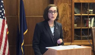"""Gov. Kate Brown, a Democrat, was lauded by NARAL Pro-Choice Oregon for signing """"the nation's most progressive reproductive health bill."""" (Associated Press)"""